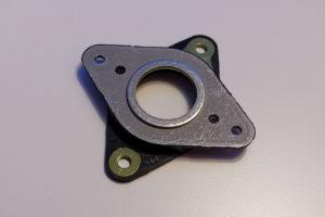 Ein Schwingungsdämpfer, der zwischen Schrittmotor und Montagewinkel geschraubt wird, um Schwingungen vom Motor nicht auf den Untergrund zu übertragen.